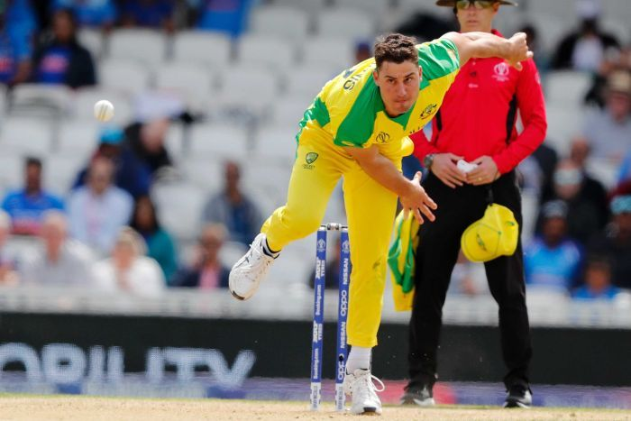 Marcus Stoinis looks down the pitch in his bowling stride