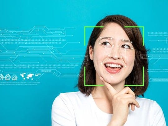 An illustration of facial recognition technology being used on a woman. Her face is surrounded by green lines, while other lines outline the features of her face.