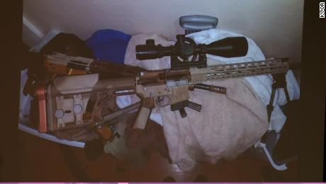 Officers found two assault rifles, a handgun and a shot gun in the main home as well as two weapons in the adjacent house.