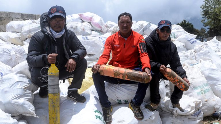 Nepali climbers pose for photographs after collecting waste from the Mount Everest at Namche Bazar, on May 27, 2019, before it is transported to Kathmandu to be recycled. - Nepal government sent a dedicated clean-up team to Mount Everest this season with a target to bring back 10,000 kilograms (10 tonnes) of trash in an ambitious plan to clean the world's highest rubbish dump. (Photo by PRAKASH MATHEMA / AFP)        (Photo credit should read PRAKASH MATHEMA/AFP/Getty Images)
