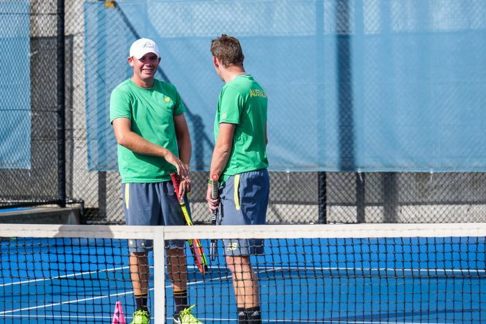 Tennis player Archie Graham and his teammate.