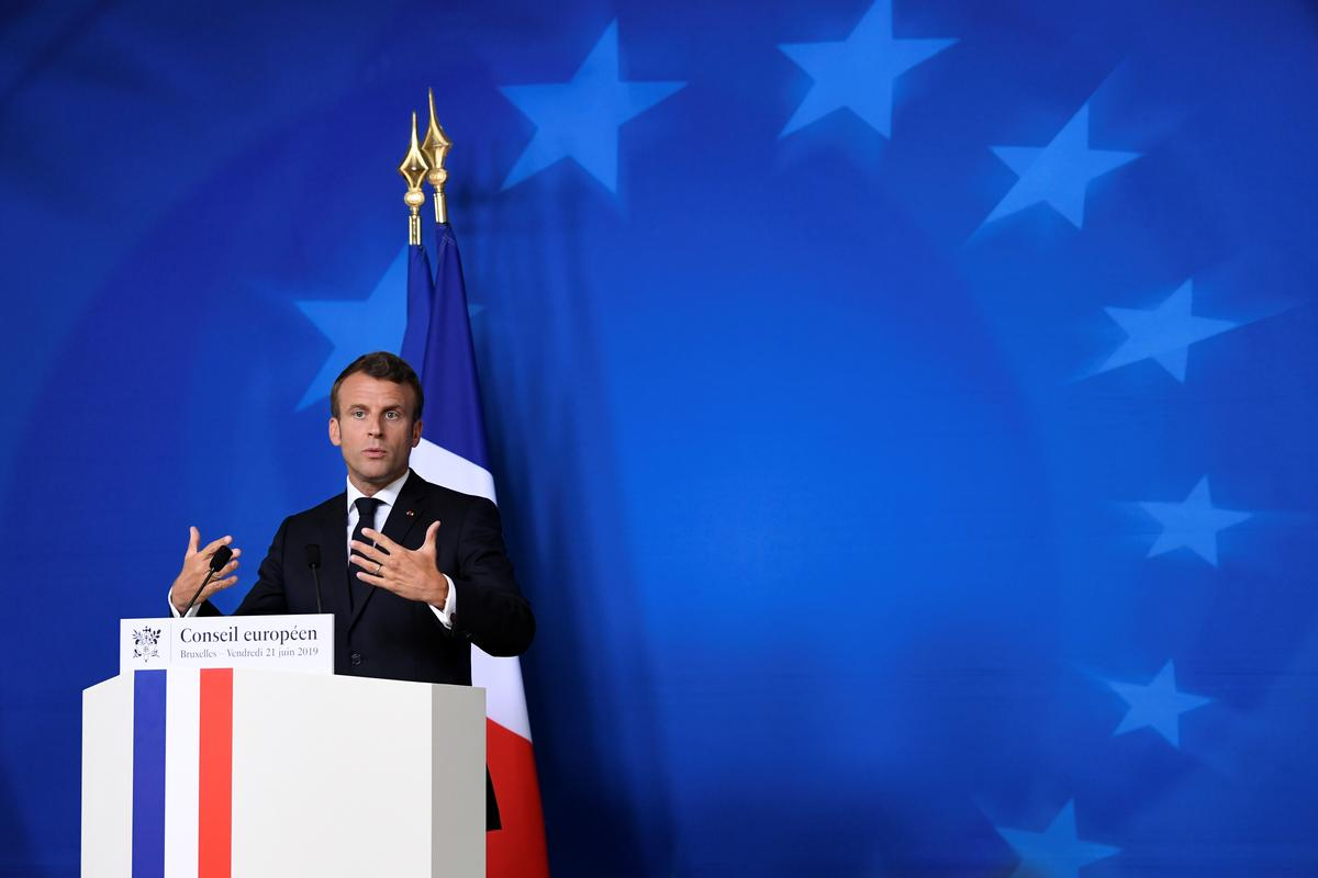 Macron says he warned Iran's Rouhani about breaking nuclear commitments