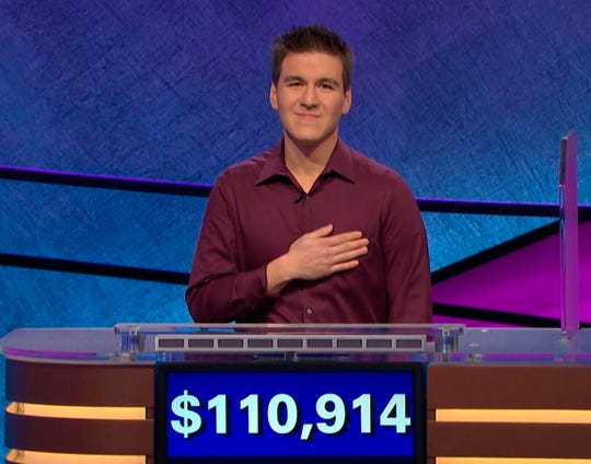 """This image made from video aired on """"Jeopardy!"""" on Tuesday, April 9. 2019, and provided by Jeopardy Productions, Inc. shows James Holzhauer.  The 34-year-old professional sports gambler from Las Vegas won more than $110,000 on """"Jeopardy!"""" on Tuesday, breaking the record for single-day cash winnings. (Jeopardy Productions, Inc. via AP) ORG XMIT: NYHK206"""