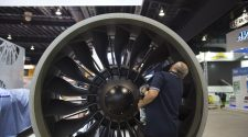 A man cleans a PW1000G geared turbofan engine developed by MTU Aero Engines AG and Pratt & Whitney, a unit of United Technologies Corp., at the Singapore Airshow held at the Changi Exhibition Centre in Singapore, on Monday, Feb. 10, 2014.