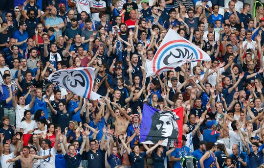 French fans wave flags during their quarterfinal match against the United States.