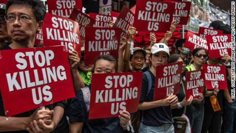 Protesters hold placards during a demonstration against the now-suspended extradition bill on June 16, 2019 in Hong Kong.