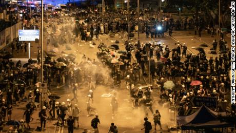 Police fire tear gas at protesters outside the Legislative Council Complex in the early hours of July 2, 2019 in Hong Kong, China.