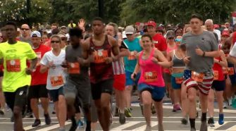 Runners in the AJC Peachtree Road Race