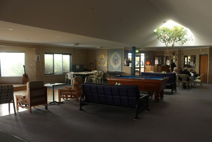 Inside the Mission to Seafarers, with pool tables, comfortable chairs, a guitar, and a skylight.