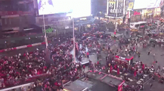 Backfires and falling sign spark panic in Times Square, Utah after shootings