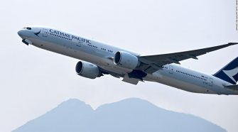 Cathay Pacific says workers who protest in Hong Kong will be suspended from mainland China flights