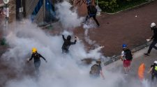 China Warns Hong Kong Protesters Not to 'Take Restraint for Weakness'