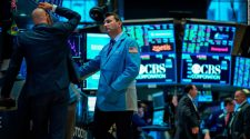 Dow caught in choppy trading after bond market flashes another recession warning