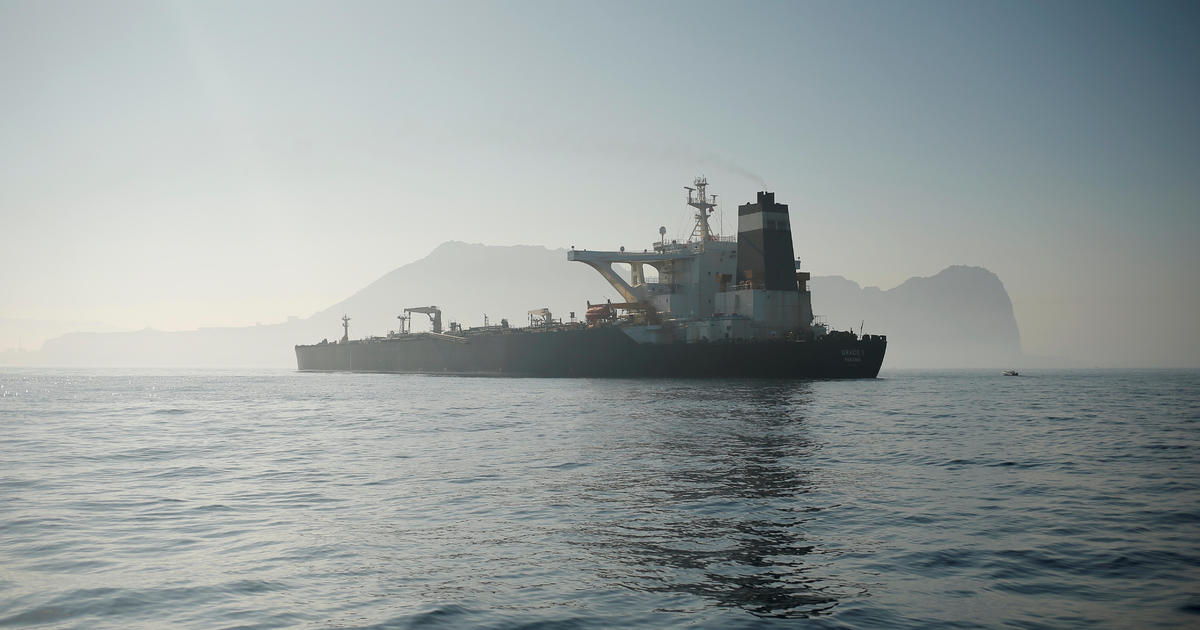 FILE PHOTO: Iranian oil tanker Grace 1 sits anchored after it was seized in July by British Royal Marines off the coast of the British Mediterranean territory, in the Strait of Gibraltar