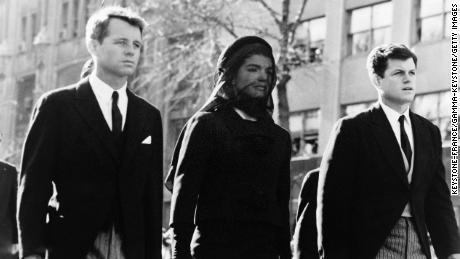 Robert Kennedy and Edward Kennedy with their sister-in-law Jacqueline Kennedy during the funeral of President John F.  Kennedy.