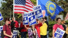 GM reinstates health insurance for striking UAW members
