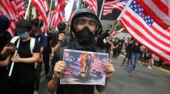 Hong Kong protesters march to US Consulate to call for help from Trump