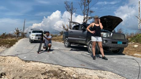 CNN producer Jaide Timm- Garcia and photojournalist Jose Armijo set up for a liveshot from the hard-hit town of High Rock on Grand Bahama.