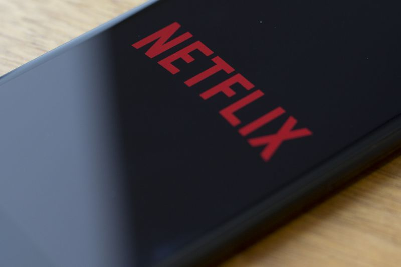 The Netflix logo is seen on a phone in this photo illustration in Washington, DC, on July 10, 2019. (Photo by Alastair Pike / AFP) (Photo credit should read ALASTAIR PIKE/AFP/Getty Images)