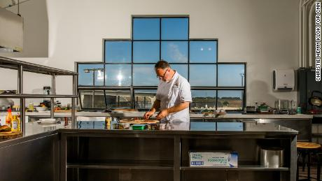 Tucker Bunch, culinary innovation and development chef at Sweet Earth, prepares food in the office's test kitchen.