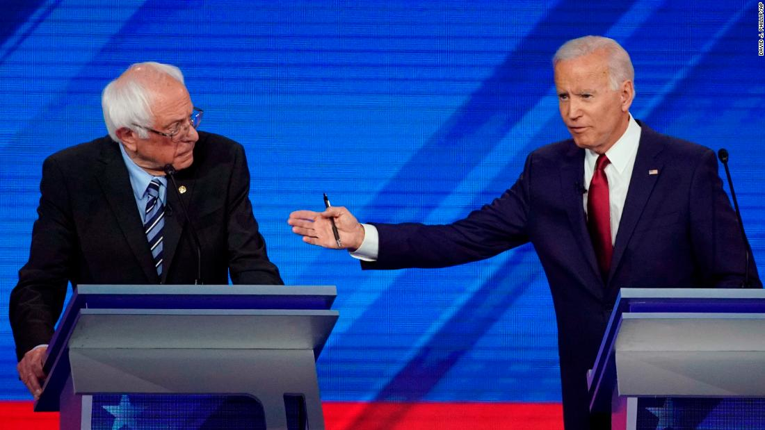 Sanders and Biden battle over health care for union workers as UAW strikes