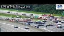 Massive police presence shuts down I-75 after crash