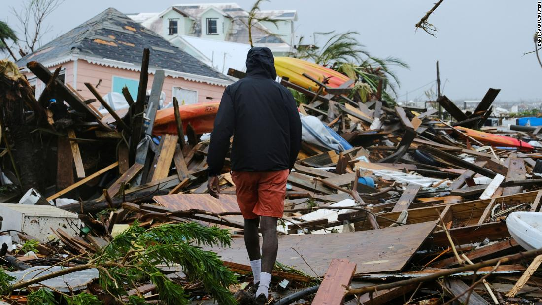 He tried to save his son by putting him on a roof. A storm surge swallowed the 5-year-old