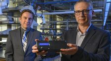 Professor of Chemistry Alexander Star, left, and associate professor of electrical and computer engineering Ervin Sejdic, pose with the prototype of the THC Breathalyzer developed using their interdisciplinary research. Current testing methods for tetrahydrocannabinol (THC), the psychoactive compound in marijuana, rely on blood, urine or hair samples and cannot be done in the field. The prototype works similar to a breathalyzer for alcohol, with a plastic casing, protruding mouthpiece and digital display.