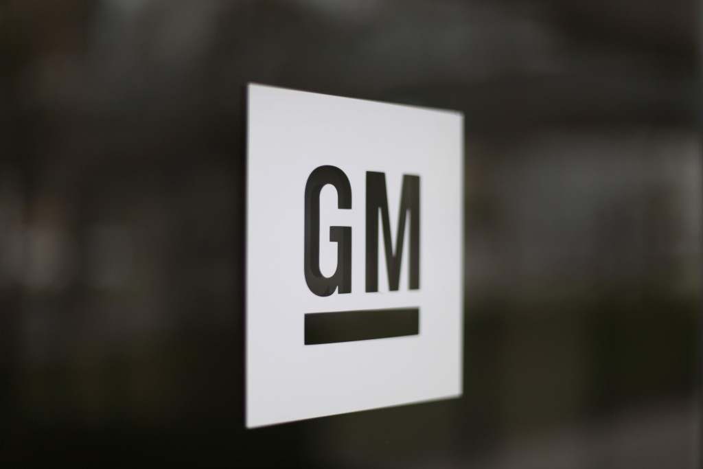 FILE - This May 16, 2014, file photo shows the General Motors logo at the company's world headquarters in Detroit. The United Auto Workers union is le