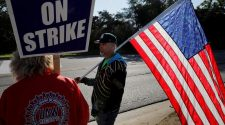 GM appeals directly to employees as strike losses mount, riling UAW