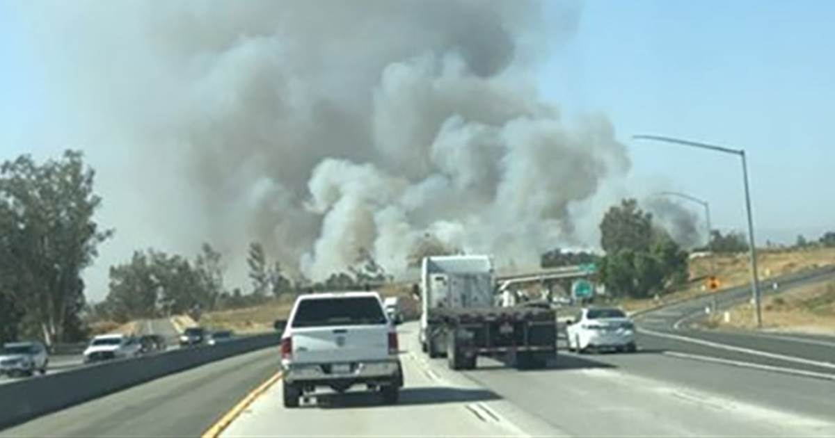 Crews battle fast-moving brush fire just outside L.A. hours after blaze tears through mobile home park