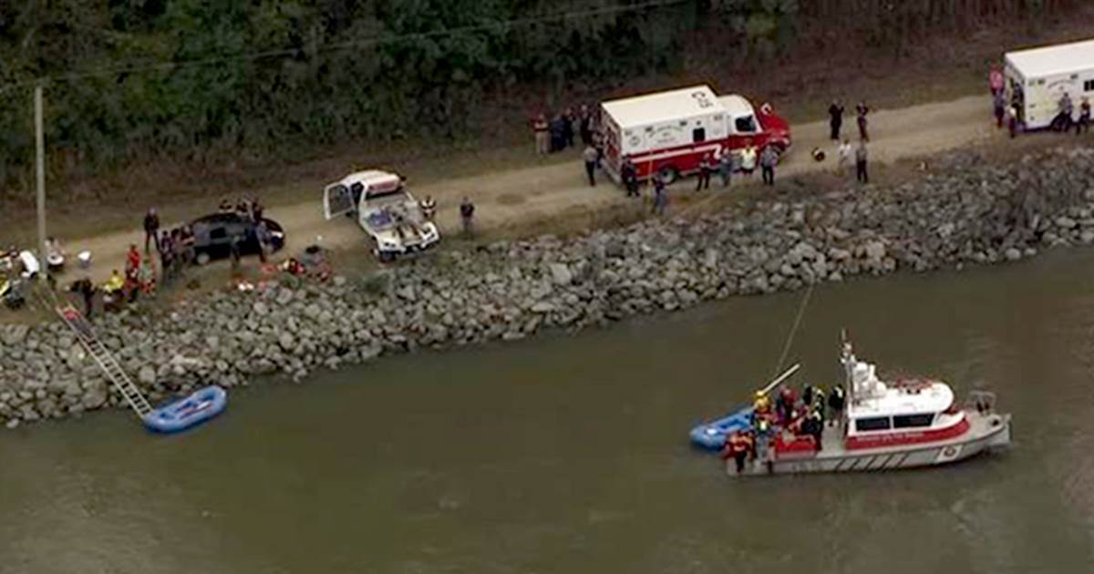 Driver dies trying to rescue passengers from submerged car; two others found dead