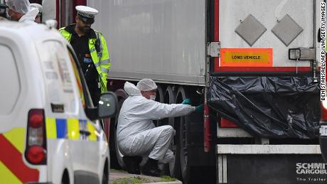 British Police forensics officers work on ther lorry found to be containing 39 dead bodies, at Waterglade Industrial Park in Grays, east of London, on October 23, 2019.
