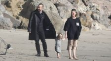 Sweet: Aaron Paul spent some quality family time with his wife Lauren Parsekian and their daughter Story Annabelle during a photoshoot on a beach in Malibu, California on Friday