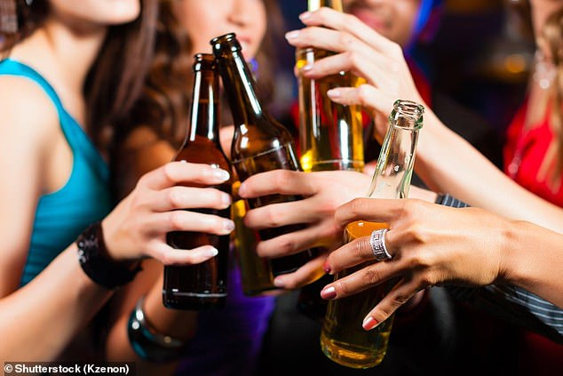 People in the US drink exactly the average amount of alcohol, but those in the UK consume 800ml more each year, according to new research (stock image)