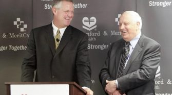 Sanford Health President and CEO Kelby Krabbenhoft, left, and MeritCare President and CEO Dr. Roger Gilbertson during a light moment at the Nov. 2, 2009, announcement of the merger of the two health care organizations. Forum file photo