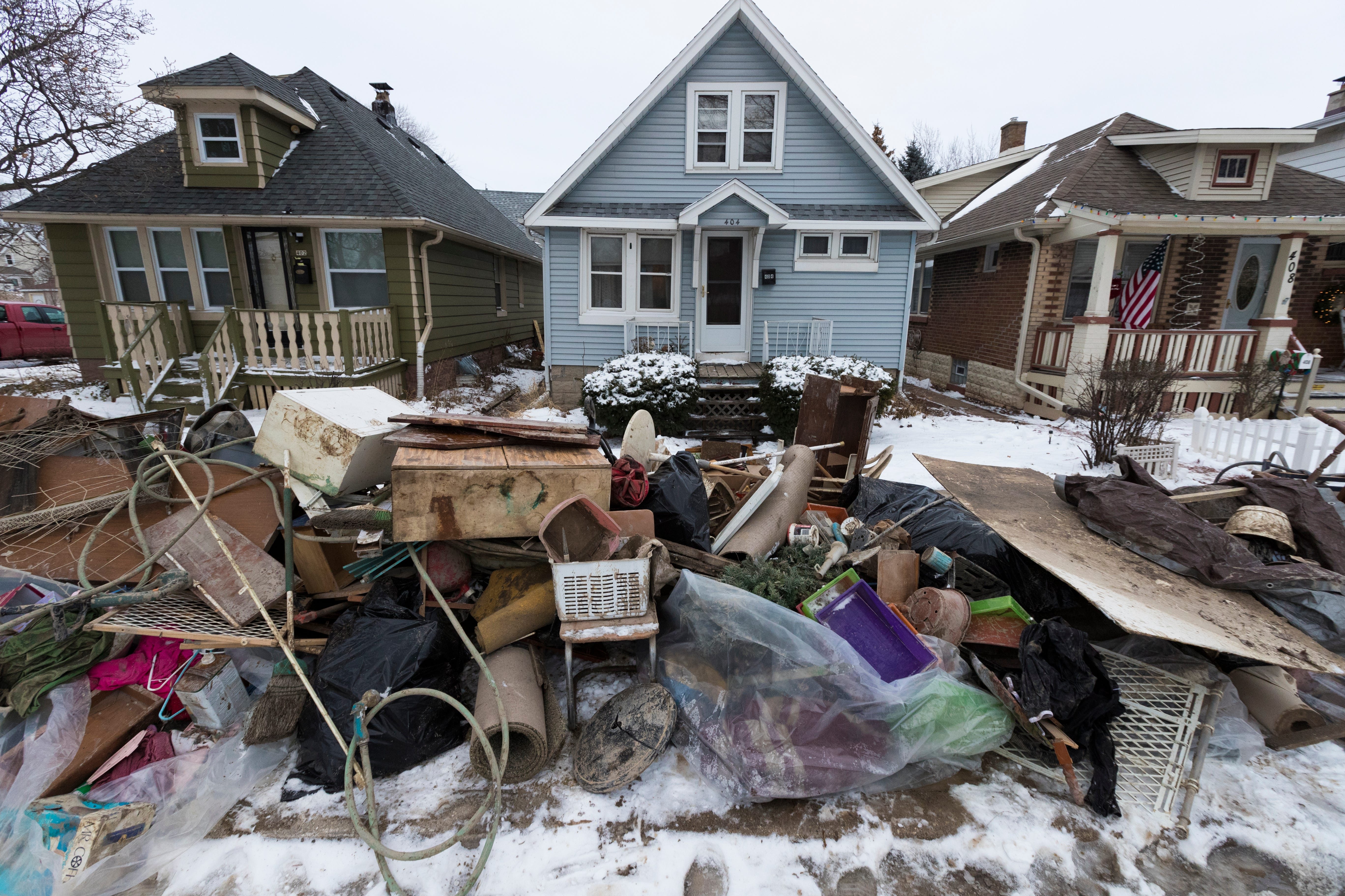 Water-damaged items from flooded basements wait to be picked up Tuesday   in the 400 block of South 60th Street in Milwaukee. The flooding was caused by a  water main break at Hawley Road just south of I-94 Saturday.