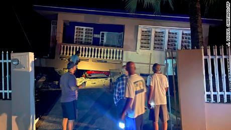 A building collapsed and crushed a car in Yauco, Puerto Rico.  All the occupants of the home are reported to be uninjured.