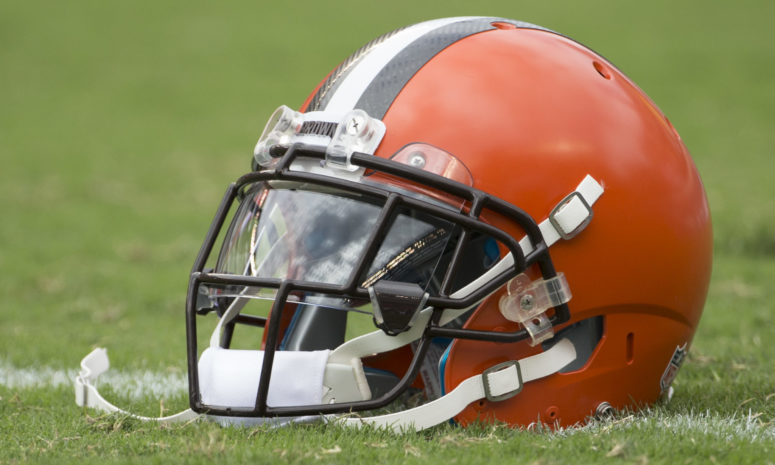 A Cleveland Browns helmet sitting on the field.