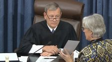 Chief Justice John Roberts says he won't break tie votes in Senate impeachment trial