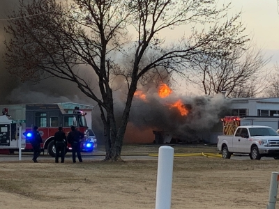 Fire destroys mobile home, sends one person to Newman Regional Health