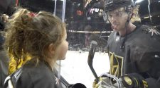 Vegas Golden Knights defenseman Jon Merrill sticks his tongue out at his daughter as he warms u ...