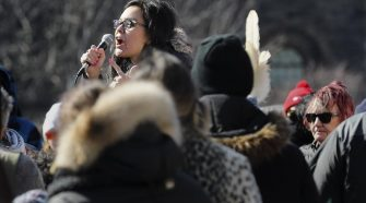 Eve Saint, a Wet'suwet'en land defender and daughter of hereditary Chief Woos, who was arrested by RCMP during the recent raids addresses the crowd at Queen's Park on Saturday. As Wet'suwet'en Hereditary Chiefs visit blockades in Eastern Canada, thousands took to Toronto streets in solidarity.
