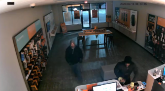 Suspects caught on camera using brick to break into Boost Mobile