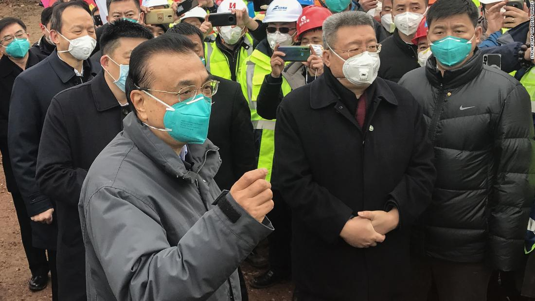 China's premier warns local officials not to hide new coronavirus infections
