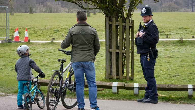 A police officer has been stopping cyclists in Richmond Park