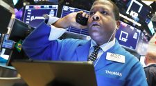 Stocks halted, Dow drops 1,600, virus cases jump