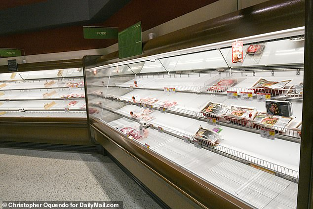 Shelves at this Publix in Atlanta are seen stripped bare last month after panic buying. Plant closures now threaten the supply of pork in the US, raising the possibility of shortages