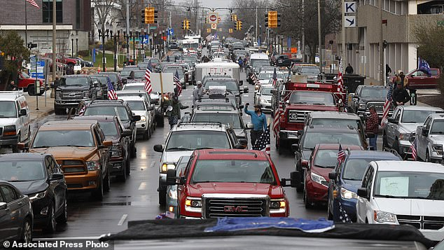 Furious demonstrators gathered Wednesday at Michigan's state Capitol, creating a massive traffic jam filled with honking cars and flag-waving protesters in defiance of the state's stringent statewide stay-at-home orders - demanding that they are lifted