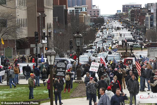 Protesters gather at the Michigan State Capitol in Lansing to show their displeasure with Gov. Gretchen Whitmer's orders to keep people at home and businesses locked